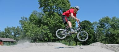 cyclist wearing protective equipment on BMX track at Bruces Mill Conservation Park