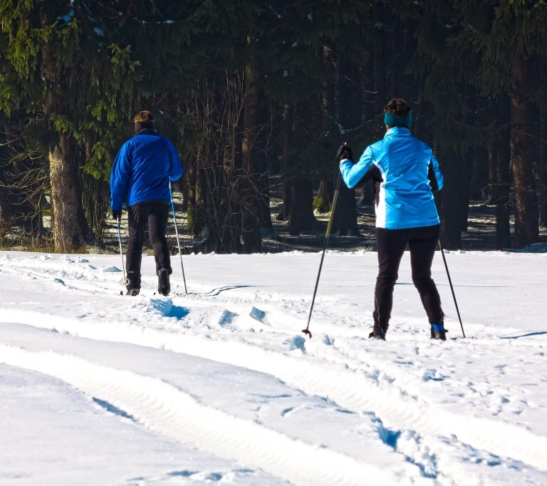 Two people cross country skiing