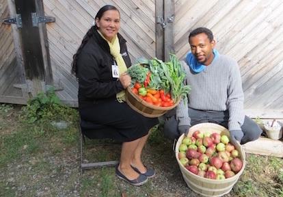 Residents display the fruits of the Black Creek SNAP surplus harvest program