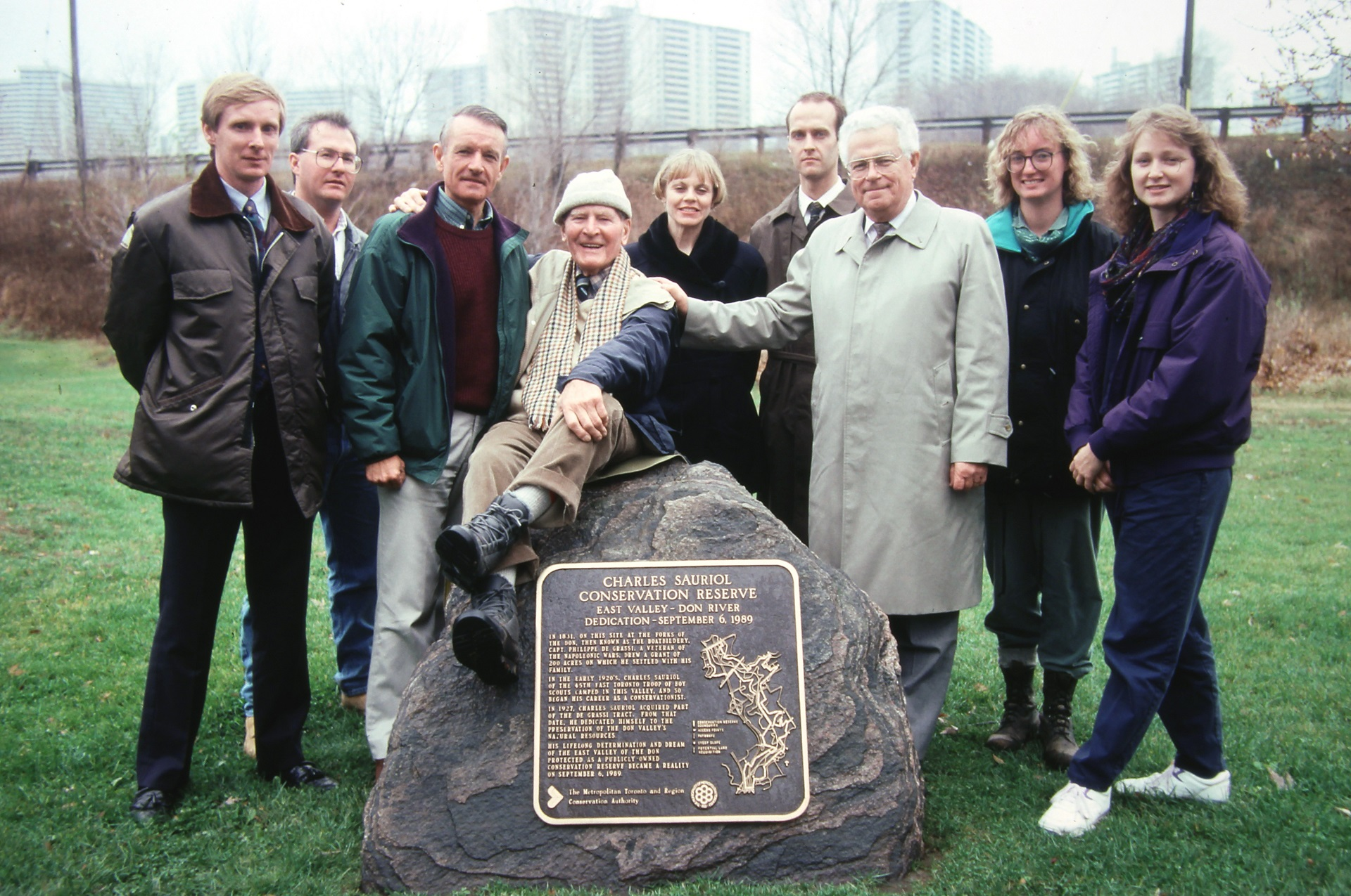 Charles Sauriol poses with the plaque bearing his name at the Charles Sauriol Conservation Reserve in 1989
