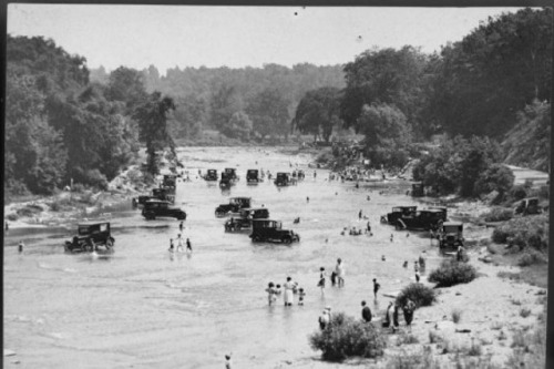 OId photo of people washing cars in the Humber River
