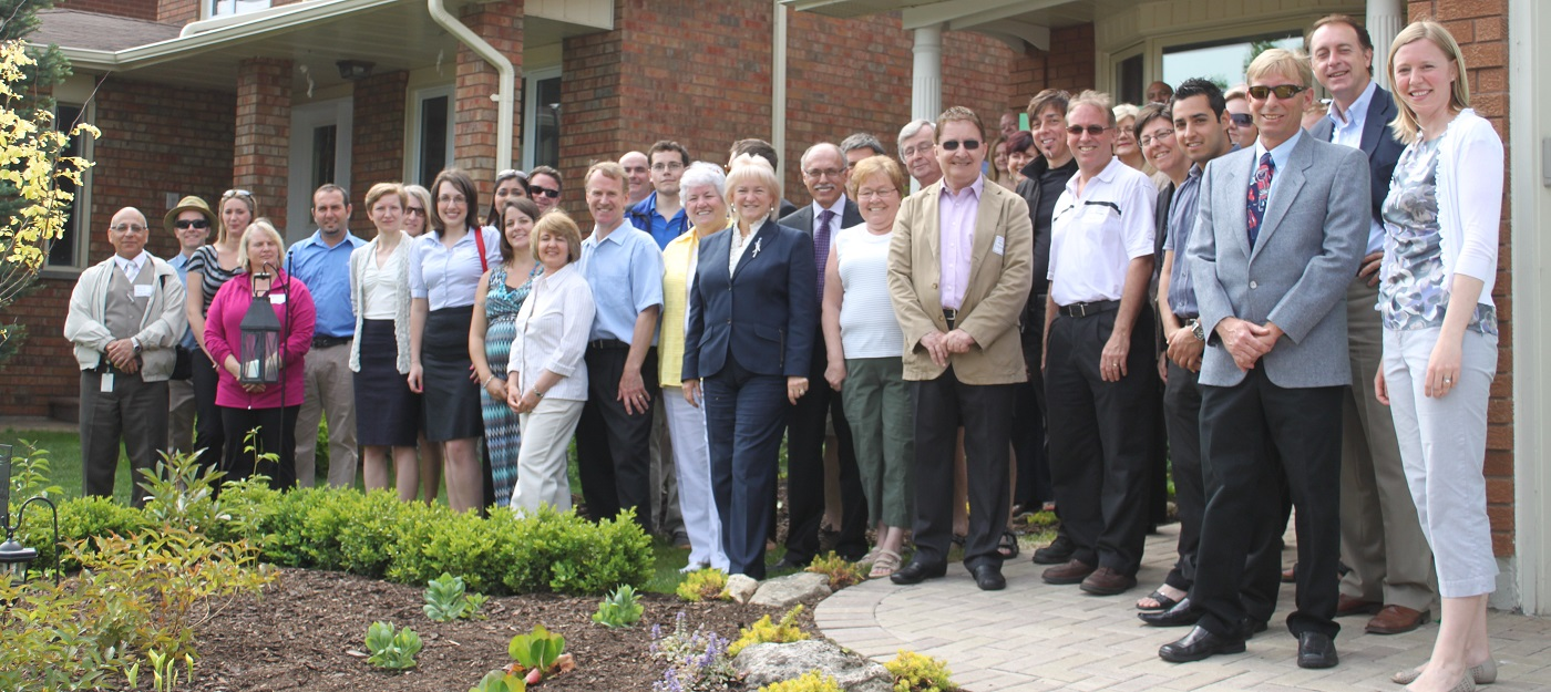 SNAP team and County Court SNAP neighbourhood residents at Green Home Makeover ribbon cutting