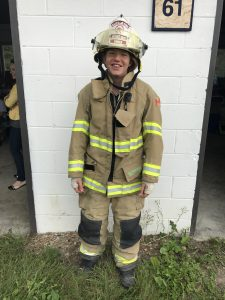 Young woman in a fire fighter's outfit