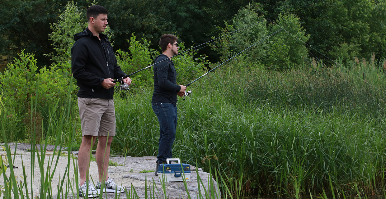 two young men fishing at Heart Lake Conservation Area