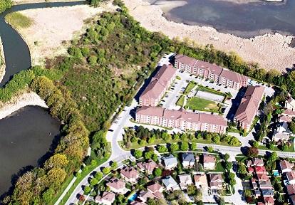aerial view of suburban neighbourhood next to waterway