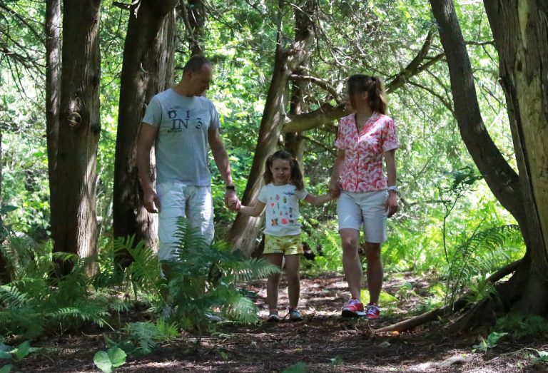 parents and young daughter enjoy trail walk at Claremont Nature Centre