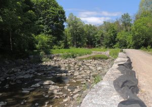 Armourstone wall, riffle, and gravel path along Wilket Creek Park.