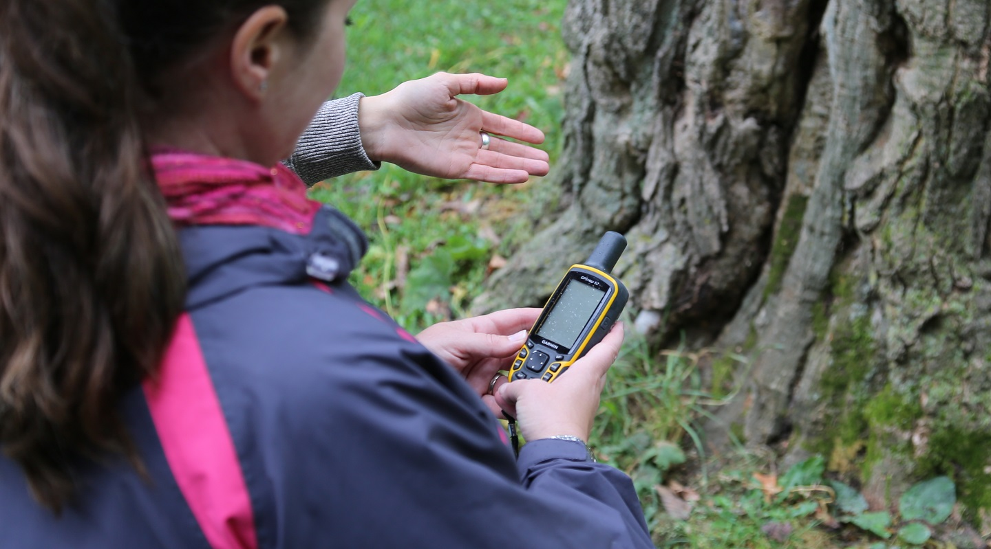 teachers use GPS device during orienteering workshop at Lake St George Field Centre