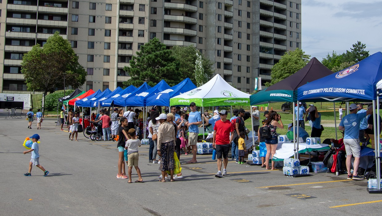 community event hosted on greenspace near residential towers