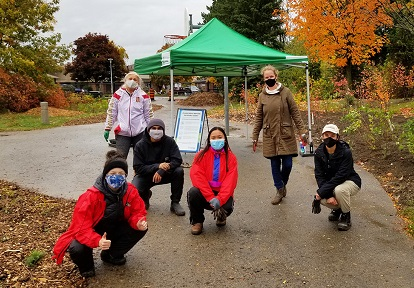 garden steward volunteers taking part in West Bolton SNAP depaving project at Heritage Hills Parkette in Caledon