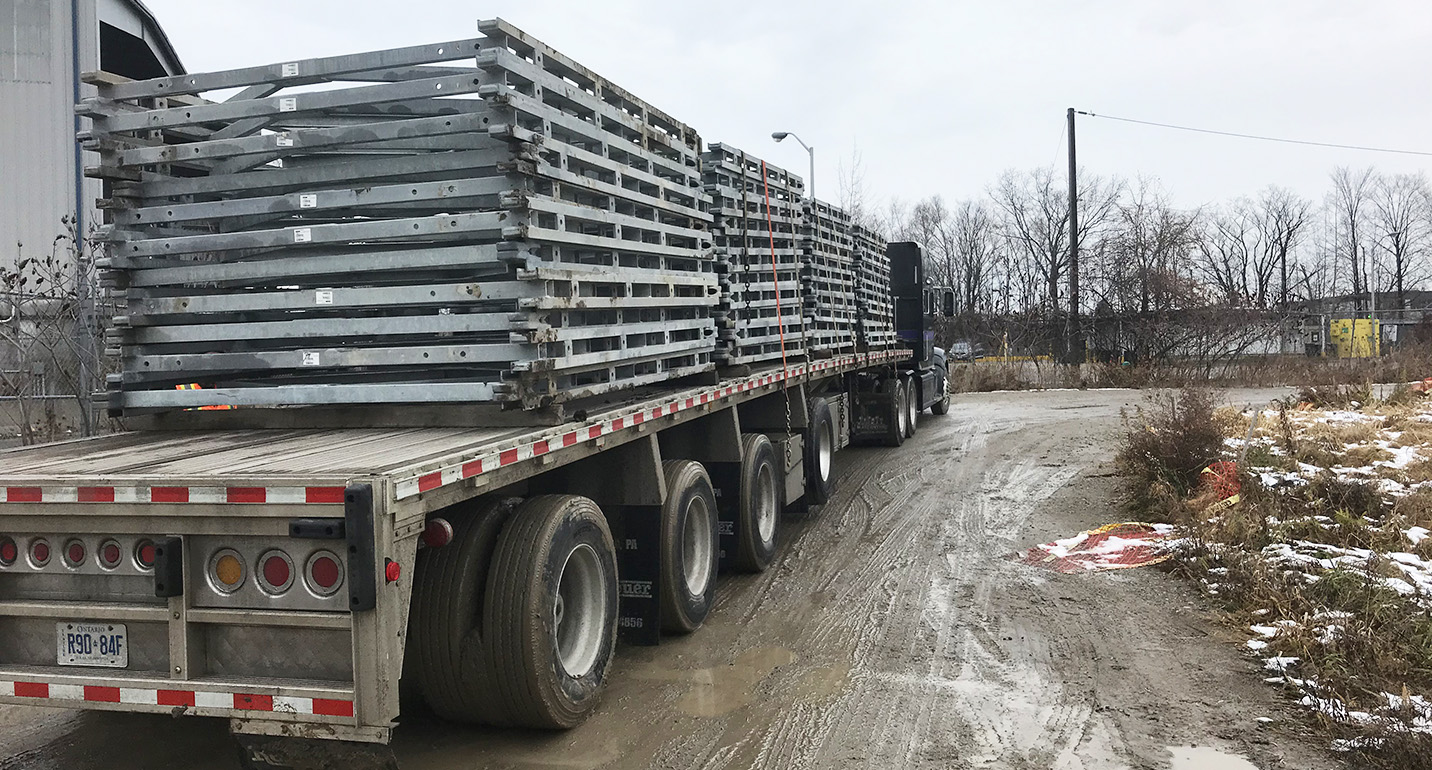 temporary East Don Trail bridge being transported off-site by a tractor trailer