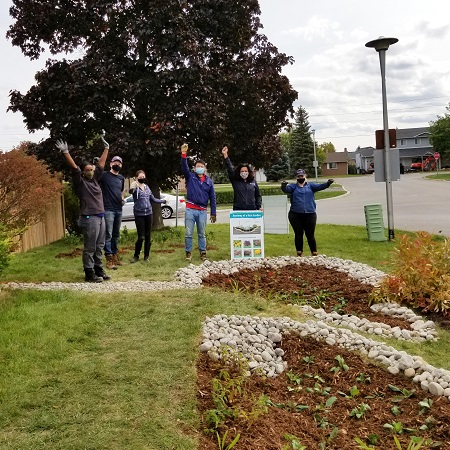 West Bolton SNAP Green Home Makeover homeowners and neighbours participate in outdoor garden implementation day