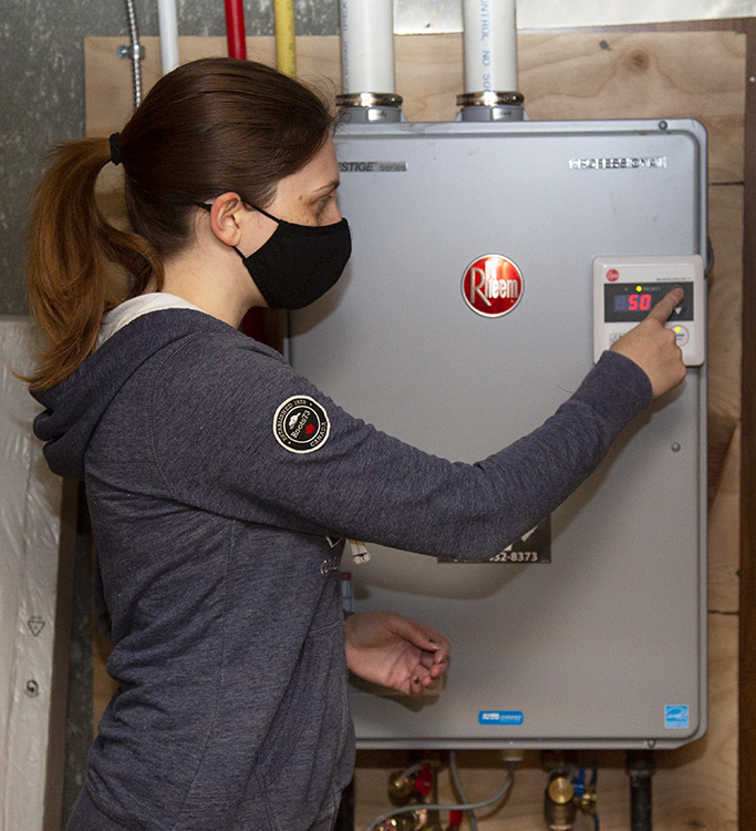 West Bolton SNAP Green Home Makeover Homeowners showcase their new energy efficient tankless water heater and furnace