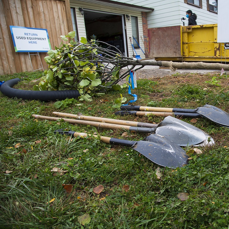 West Bolton SNAP Green Home Makeover homeowners and neighbours plant trees on their property to increase canopy