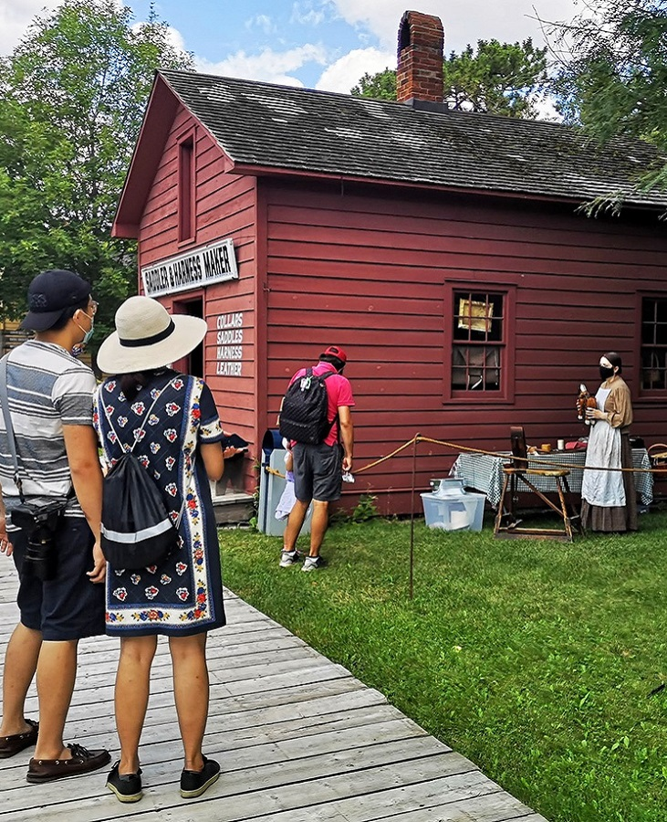 Visitors enjoy a self-guided tour of the heritage buildings at Black Creek Pioneer Village