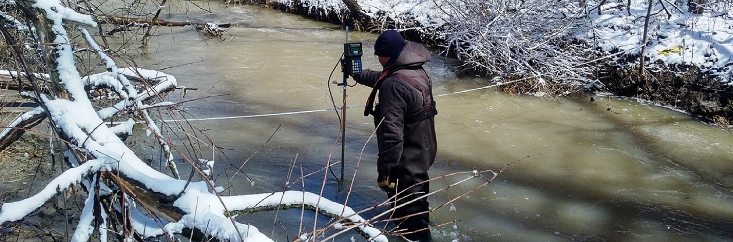 TRCA team member monitoring stream water levels in early spring