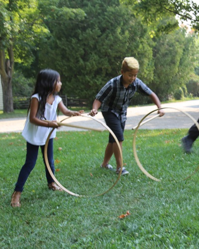 summer campers play 19th century sports and games at Black Creek Pioneer Village