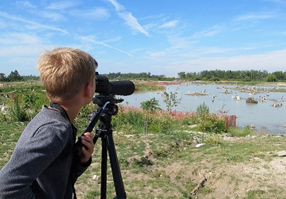 summer camper enjoys an introduction to bird watching at Tommy Thompson Park