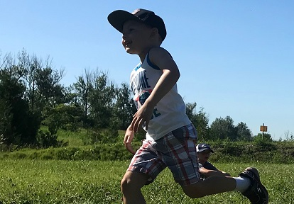 summer camper enjoys outdoor activity at Claremont Nature Centre
