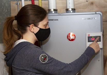 homeowner demonstrates benefits of home efficiency retrofit