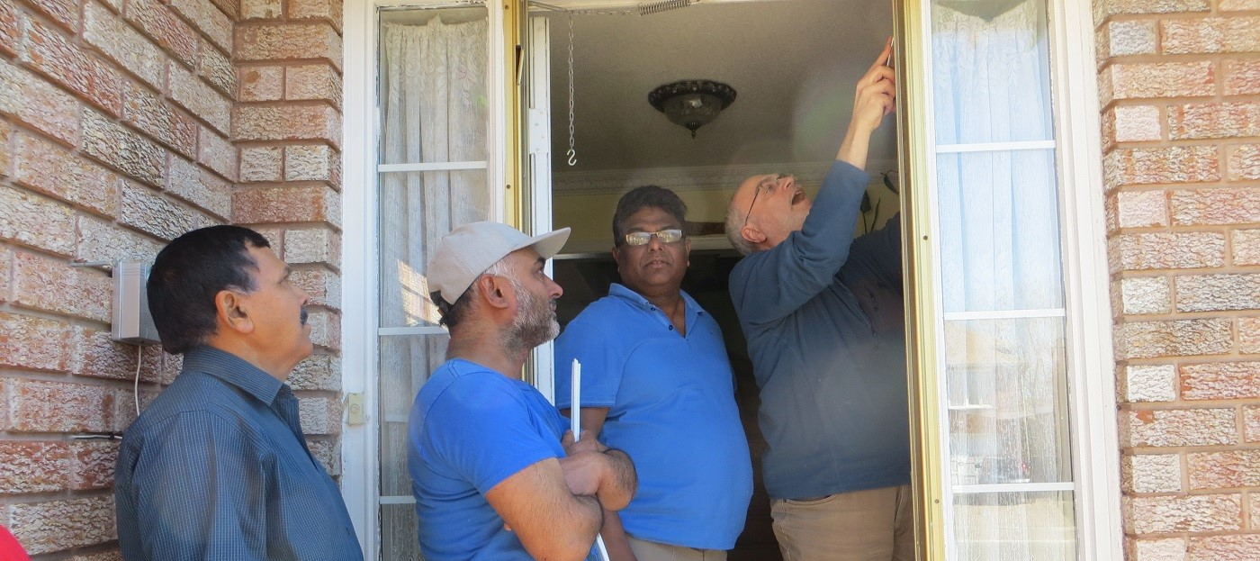 County Court SNAP residents watch a demonstration of a do-it-yourself home energy retrofit