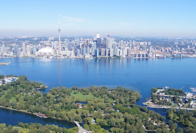 view of Toronto skyline and Lake Ontario waterfront with Toronto Islands in foreground