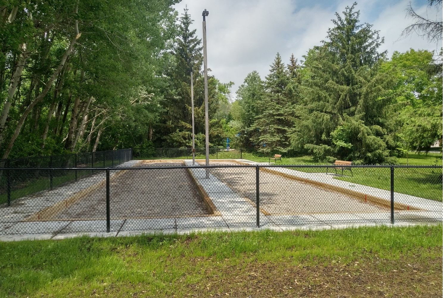 View of recently constructed bocce courts with park benches