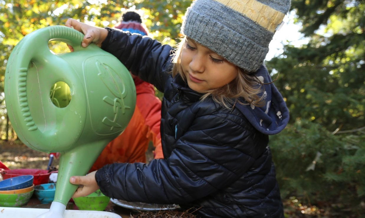 preschool student takes part in outdoor learning experience at the Nature School at Claireville