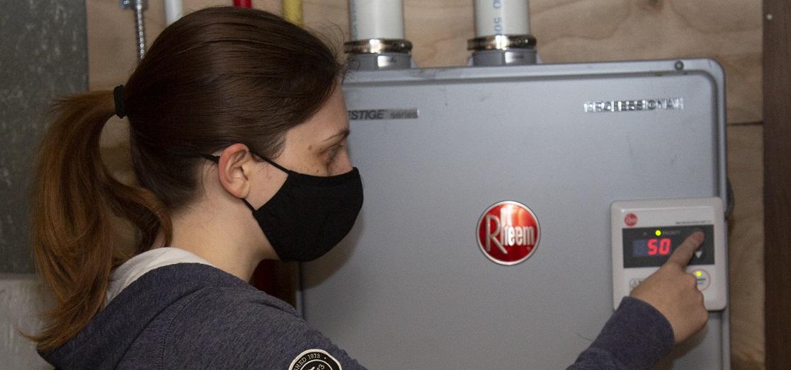 young woman installing energy saving home retrofits
